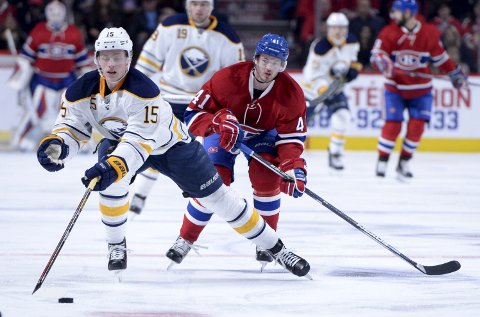Mar 10, 2016; Montreal, Quebec, CAN; Buffalo Sabres forward Jack Eichel (15) plays the puck as Montreal Canadiens forward Paul Byron (41) chases during the third period at the Bell Centre. Mandatory Credit: Eric Bolte-USA TODAY Sports