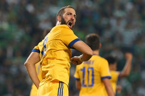 Juventus' Gonzalo Higuain celebrates after scoring his side's opening goal during a Champions League, Group D, soccer match between Sporting CP and Juventus at the Alvalade stadium in Lisbon, Tuesday, Oct. 31, 2017. (AP Photo/Armando Franca)