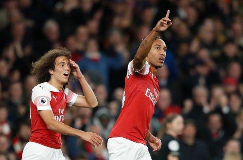 Arsenal og Pierre-Emerick Aubameyang (t.h.) skal forsøke å komme tilbake på vinnersporet i løradegsn kamp mot Burnley. Det tror vi de klarer. (AP Photo/Alastair Grant)