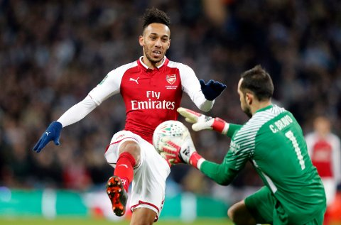 Arsenal's Pierre-Emerick Aubameyang, left, challenges Manchester City goalkeeper Claudio Bravo during the English League Cup final soccer match between Arsenal and Manchester City at Wembley stadium in London, Sunday, Feb. 25, 2018. (AP Photo/Frank Augstein)