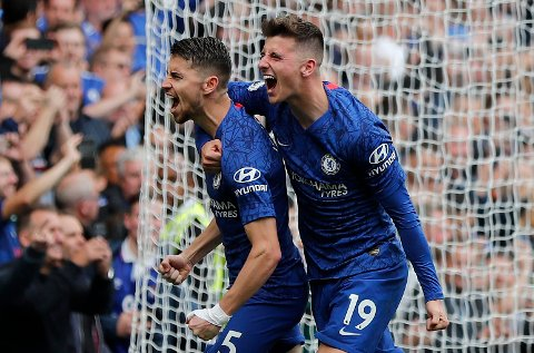 Chelsea's Jorginho, left, and Chelsea's Mason Mount celebrate after scoring their side's first goal during the English Premier League soccer match between Chelsea and Brighton & Hove Albion at Stamford Bridge stadium in London, Saturday, Sept. 28, 2019.(AP Photo/Frank Augstein)