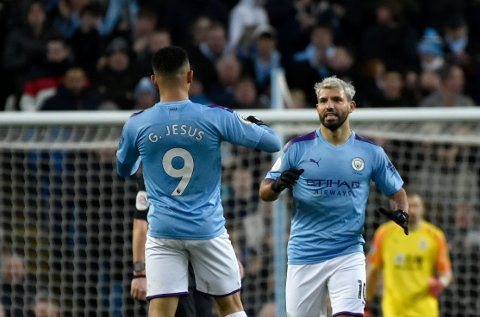 Manchester City's Sergio Aguero, right, celebrates with Manchester City's Gabriel Jesus after scoring his side's opening goal during the English Premier League soccer match between Manchester City and Crystal Palace at Etihad stadium in Manchester, England, Saturday, Jan. 18, 2020. (AP Photo/Rui Vieira)