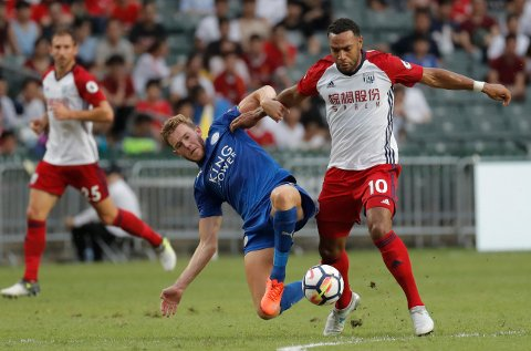 Matt Phillips of West Bromwich Albion FC, right, is tackled by Callum Elder of Leicester City FC during a day one match at the Premier League Asia Trophy soccer tournament in Hong Kong, Wednesday, July 19, 2017. (AP Photo/Kin Cheung)