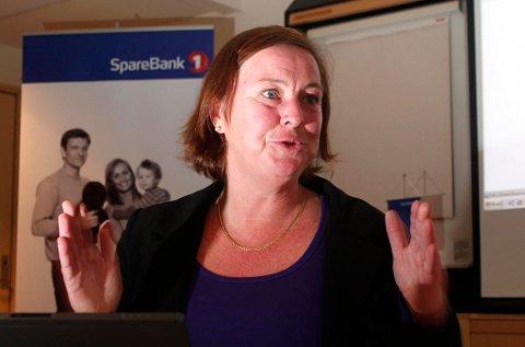 FLYTTER BANKKUNDER: I ti år har Elisabeth Realfsen, daglig leder og redaktør i Finansportalen.no, gitt bankkunder ammunisjon til å presse ned prisene på banklån. Foto: Heiko Junge (NTB scanpix)