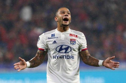Memphis Depay skal skyte Lyon til sluttspillet i kveldens hjemmekamp mot RB Leipzig.    (AP Photo/Laurent Cipriani)