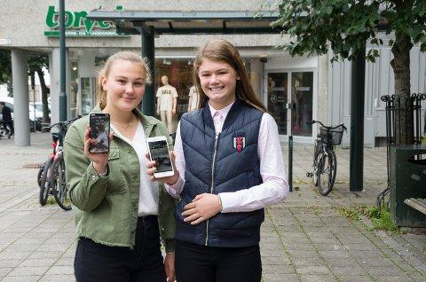 GLEDER SEG: Hanna Rustad (17) og Elise Bråten Thompson (13) vil gjerne bruke aktivitetsappen. De mener den kan hjelpe barn og ungdom fra familier med lav inntekt å få komme inn på konserter og idrettsarrangementer.