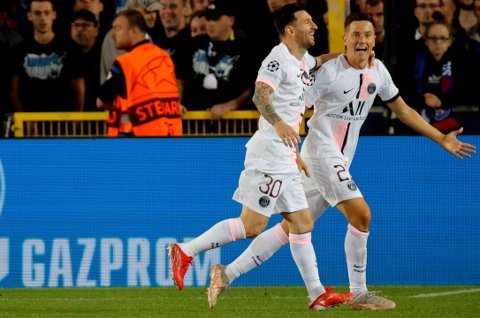 PSG's Ander Herrera, right, celebrates with PSG's Lionel Messi after scoring the opening goal of the match during the Champions League Group A soccer match between Club Brugge and PSG at the Jan Breydel stadium in Bruges, Belgium, Wednesday, Sept. 15, 2021. (AP Photo/Olivier Matthys)