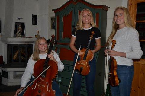 Garvik-trio: Marit Ingeborg (f.v.) på cello, Sigrid Andrine på bratsj og Maria Lill på fiolin, har sett saman ein times konsert til støtte for kyrkjebygging i Tallinn. Dei lovar klassisk og pop, norsk og estisk.