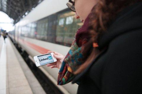 Smarttelefonen er blitt et uunnværlig tilbehør på reisen. (Foto: Jan Haas, NTB scanpix/ANB)