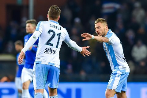 Lazio midfielder Sergej Milinkovic Savic, left, celebrates with his teammate Ciro Immobile after scoring his side's first goal during the Italian Serie A soccer match between Sampdoria and Lazio at the Luigi Ferraris stadium in Genoa, Italy, Sunday, Dec. 3, 2017. (Simone Arveda/ANSA via AP)