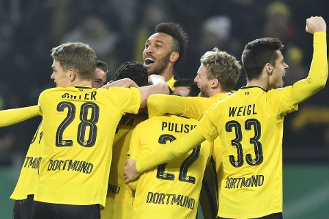 Dortmund's Pierre-Emerick Aubameyang, center, celebrates with his team winning the German soccer cup match between Borussia Dortmund and Hertha BSC Berlin after penalty shootout in Dortmund, Germany, Wednesday, Feb. 8, 2017. (AP Photo/Martin Meissner)