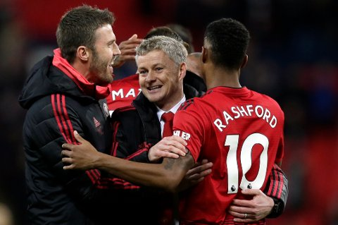 Manchester United caretaker manager Ole Gunnar Solskjaer, center, celebrates with Manchester United's Marcus Rashford, right, at the end of the English Premier League soccer match between Tottenham Hotspur and Manchester United at Wembley stadium in London, England, Sunday, Jan. 13, 2019. Manchester United won 1-0. (AP Photo/Tim Ireland)