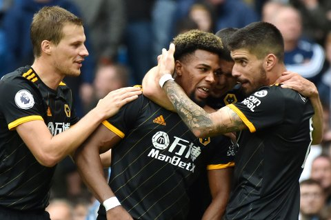 Wolverhampton Wanderers' Adama Traore, centre, celebrates with teammates after scoring during the English Premier League soccer match between Manchester City and Wolverhampton Wanderers at Etihad stadium in Manchester, England, Sunday, Oct. 6, 2019. (AP Photo/Rui Vieira)