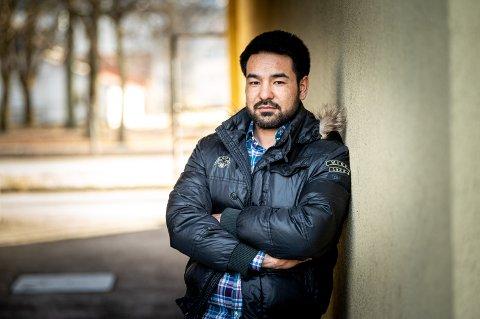 GLAD I DRAMMEN: Mohsen Yusufi elsker Drammen og hadde ikke trodd han skulle bli utsatt for hets i hjembyen.