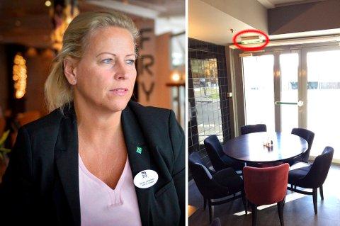 HOTELLSJEF: Janne Johansen forsikrer at brannsikkerheten tas på største alvor. Da brannvesenet hadde tilsyn på hotellet, reagerte de blant annet på at dette bordet og stolene var plassert foran en av de merkede nødutgangene fra restauranten Pi.