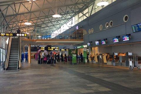 TOLIG: Avgangshallen på Tromsø lufthavn var rolig og stille torsdag morgen. Klokken fire på morgenen ble det klart at det ikke ble noe pilotstreik i SAS.