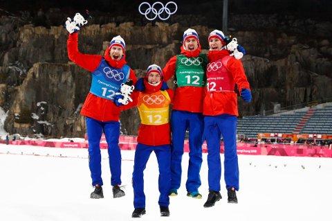 GULLGUTTA: F.v. Robert Johansson, Johann André Forfang, Andreas Stjernen og Daniel André Tande hoppende glade etter OL-gullet mandag.