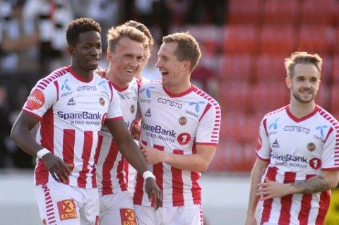 SEIER: Tromsøs Runar Espejord scoret i eliteseriekampen mot Odd på Alfheim Stadion søndag kveld. Her feirer han med Morten Gamst Pedersen og Mushaga Bakenga.
