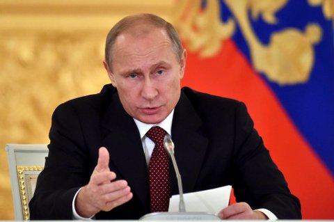 Forbes har for andre år på rad kåret Russlands president Vladimir Putin til verdens mektigste, foran USAs president Barack Obama og Kinas leder Xi Jinping. Foto: Kirill Kudrjavtsev, Reuters / NTB scanpix