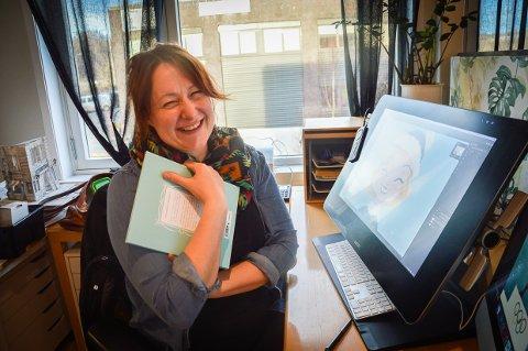 ROPTE AV GLEDE: Ingebjørg Faugstad Mæland ble så glad da et forlag ringte og ville ha henne til å illustrere barneboka om Hennie Onstad at hun ropte høyt av glede. Sønnen Ben på to år ble redd og begynte å gråte.