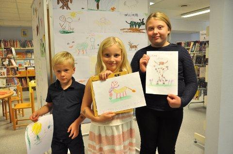 VANT: Disse tre barna vant Markens Grødes store tegnekonkurranse. Fra venstre: Andreas Dingstad (5) fra Fredrikstad, Andrea Johansen Solbrække (8) fra Degernes og Milla Sofie Heed Jensen (10) fra Marker.