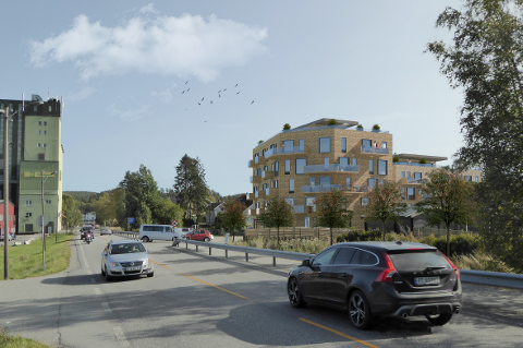 Skissen viser hvordan leilighetsbyggene kan bli seende ut. Kornsiloen på Bjørkelangen til venstre.