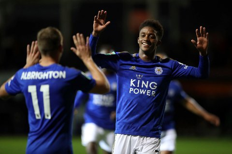 Leicester City's Demarai Gray, right, celebrates scoring his side's first goal during a English League Cup soccer match between Leicester City and Luton Town at the Kenilworth Road, Tuesday, Sept. 24, 2019, in Luton, England. (Nick Potts/PA via AP)
