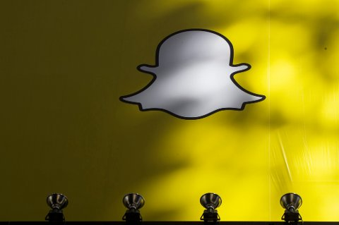 A billboard displays the logo of Snapchat above Times Square in New York March 12, 2015. REUTERS/Lucas Jackson (UNITED STATES - Tags: BUSINESS)