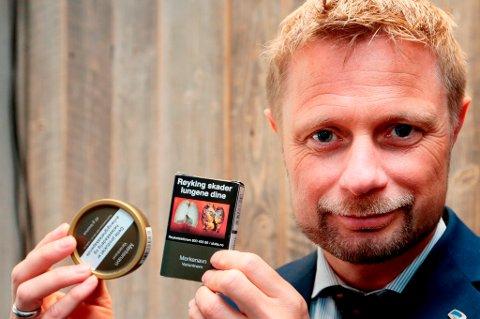 Slik vil helseminister Bent Høie kamuflere røyk og snus, i skittengrønn innpakning.