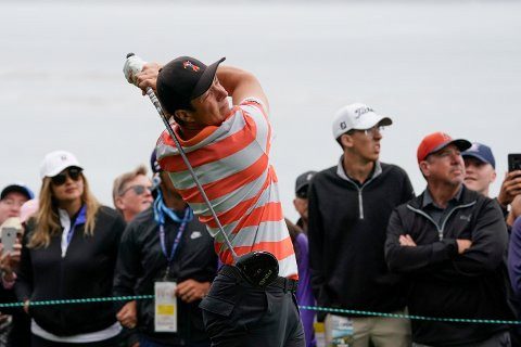 Amateur player, Viktor Hovland, of Norway, watches his tee shot on the 14th hole during the second round of the U.S. Open Championship golf tournament, Friday, June 14, 2019. (AP Photo/Carolyn Kaster)