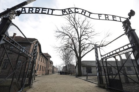 "The Nazi concentration camp Auschwitz-Birkenau in Oswiecim, Poland, is pictured on Friday, Feb. 15, 2019 prior the visit of United States Vice President Mike Pence. The sign over the gate reads ""work makes one free"". (AP Photo/Michael Sohn)"
