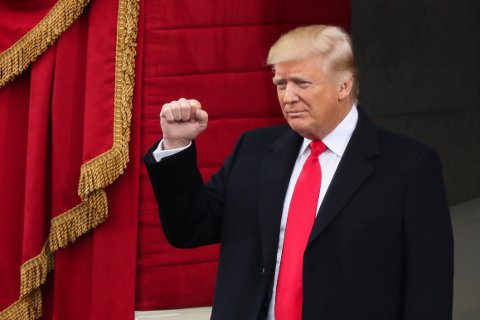 President-elect Donald Trump pumps his fist as he arrives during the 58th Presidential Inauguration at the U.S. Capitol in Washington, Friday, Jan. 20, 2017. (AP Photo/Andrew Harnik)