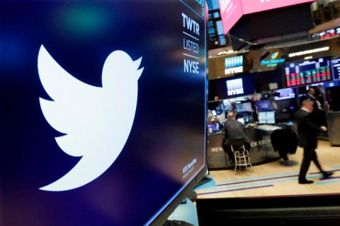 FILE- In this Feb. 8, 2018, file photo the logo for Twitter is displayed above a trading post on the floor of the New York Stock Exchange. Twitter reports earnings Wednesday, April 25, 2018. (AP Photo/Richard Drew, File)