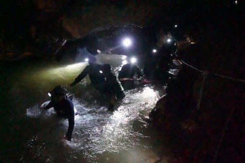 In this handout file photo released by Tham Luang Rescue Operation Center,  Monday, July 2, 2018, Thai rescue teams walk inside cave complex where 12 boys and their soccer coach went missing in Mae Sai, Chiang Rai province, northern Thailand. (Tham Luang Rescue Operation Center via AP, File)