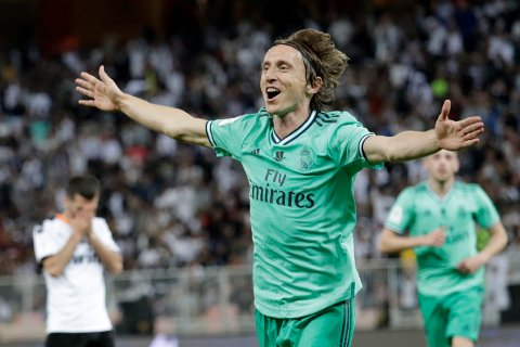 Real Madrid's Luka Modric celebrates after scoring his side's third goal during the Spanish Super Cup semifinal soccer match between Real Madrid and Valencia at King Abdullah stadium in Jiddah, Saudi Arabia, Wednesday, Jan. 8, 2020. (AP Photo/Hassan Ammar)