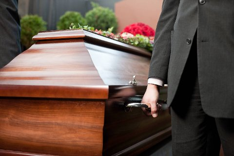 Religion, death and dolor  - coffin bearer carrying casket at funeral to cemetery; Shutterstock ID 113984353; PO: purchase_order4; Job: job1; Client: client2; Other: other3