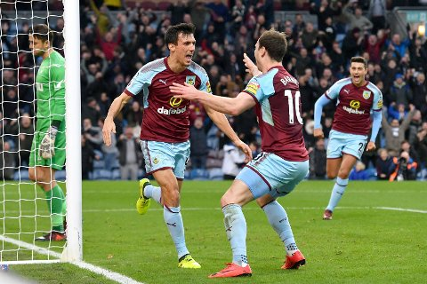 Burnley's Jack Cork, left, celebrates scoring his side's first goal of the game against Swansea City during the English Premier League soccer match at Turf Moor, Burnley, England, Saturday Nov. 18, 2017. (Anthony Devlin/PA via AP)