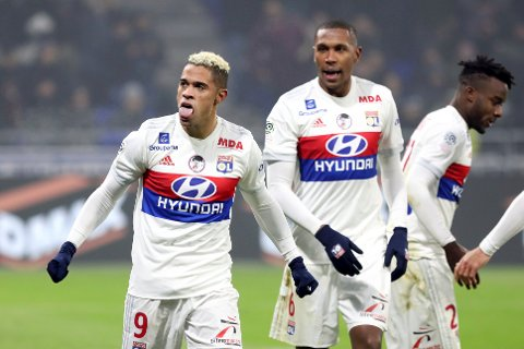 Lyon's Mariano Diaz Mejia, left, celebrates with his teammates after he scored a goal against Marseille during their French League One soccer match in Decines, near Lyon, central France, Sunday, Dec. 17, 2017. (AP Photo/Laurent Cipriani)