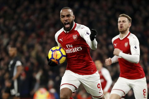 Arsenal's Alexandre Lacazette celebrates after scoring his side's first goal during the English Premier League soccer match between Arsenal and Manchester United at the Emirates stadium in London, Saturday, Dec. 2, 2017. (AP Photo/Kirsty Wigglesworth)