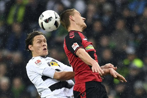 Gladbach's Jannik Vestergaard, left, and Freiburg's Nils Petersen vie for the ball during the German Bundesliga  soccer match between Borussia Moenchengladbach and SC Freiburg in the Borussia Park Stadium in Moenchengladbach, Germany, Saturday Feb. 4, 2017.   (Federico Gambarini/dpa via AP) via AP)
