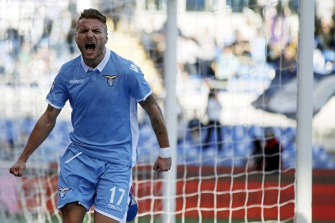 Lazio's Ciro Immobile celebrates after scoring during the Italian Serie A soccer match between Lazio and Udinese at the Olympic stadium in Rome, Italy, Sunday, Feb. 26, 2017. (Riccardo Antimiani/ANSA via AP)