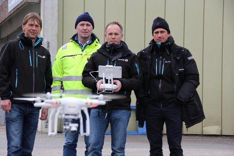 Fire av dronepilotene til Gjensidige: Arild Christophersen, Aksel Reeno Simenstad, Kjell Andre Kleven og Kenneth Thorsen.FOTO: GJENSIDIGE