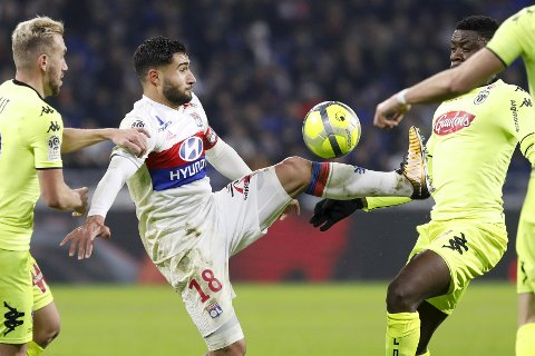 Lyon's Nabil Fekir, center, controls the ball as he challenges with Angers' players during their French League One soccer match in Decines, near Lyon, central France, Sunday, Jan. 14, 2018. (AP Photo/Laurent Cipriani)