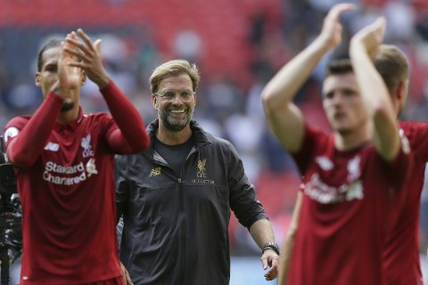 Liverpool's coach Jurgen Klopp center, celebrates with Liverpool's players after winning the English Premier League soccer match between Tottenham Hotspur and Liverpool at Wembley Stadium in London, Saturday Sept. 15, 2018. (AP Photo/Tim Ireland)