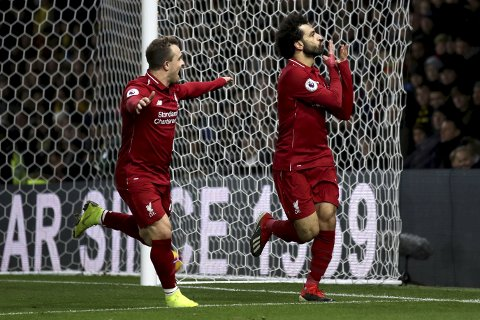 Liverpool's Mohamed Salah, right, celebrates scoring his side's first goal of the game with team mate Xherdan Shaqiri during their English Premier League soccer match against Watford at Vicarage Road, Watford, England, Saturday, Nov. 24, 2018. (Chris Radburn/PA via AP)