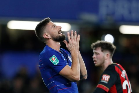 Chelsea's Olivier Giroud reacts after missing a goal opportunity during a League Cup, quarterfinal soccer match between Chelsea and Bournemouth at the Stamford Bridge stadium in London, Wednesday Dec. 19, 2018. (AP Photo/Alastair Grant)