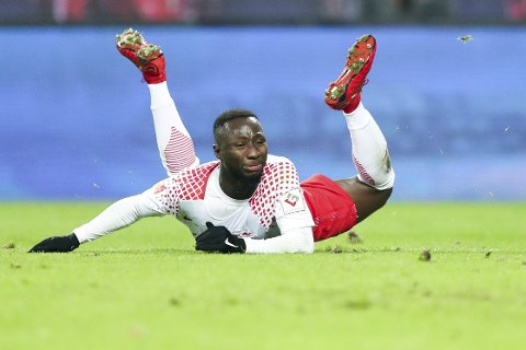 "In this Jan. 13, 2018 photo, Leipzig's Naby Deco Keita is  on the ground during the German Bundesliga soccer match between RB Leipzig and FC Schalke 04 at the Red Bull Arena in Leipzig, Germany. Leipzig ruled out a winter transfer for Naby Keita on Sunday, Jan 14, 2018, saying the Guinea midfielder will stay with the side to the end of the season. The Bundesliga side said in a tweet that Keita will stay a Leipzig player until June 30 and ""we wish to put the speculation about a January move to (Liverpool) to bed"". ( Jan Woitas/dpa via AP)"
