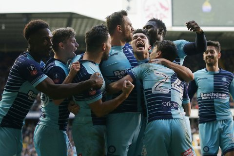 Wycombe Wanderers' Paul Hayes, centre, celebrates with his teammates after scoring a penalty during the English FA Cup fourth round match between Tottenham Hotspur and Wycombe Wanderers at White Hart Lane in London, Saturday Jan. 28, 2017. (AP Photo/Tim Ireland)