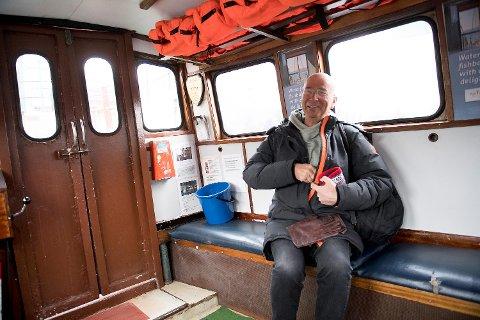 Passasjer Rolf Akselsener stårlende fornøyd med å ha Beffen tilbake.