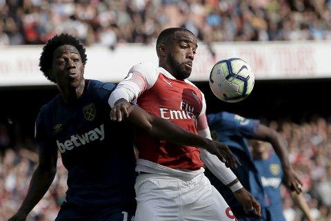 Arsenal og Alexandre Lacazette har ofte vært svake i første omgang.  (AP Photo/Tim Ireland)